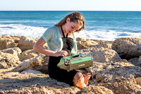 Girl with Typewriter by the Ocean I Oahu Photographer