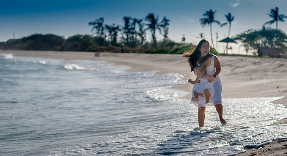Mother daughter playing in surf I Oahu Photographer